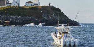 Regulator Center Console boat approaching the Montauk lighthouse